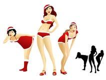 女孩性感的圣诞老人 图库摄影