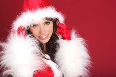 女孩性感的圣诞老人 免版税库存图片