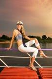 女孩性感的游艇 免版税图库摄影
