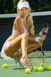 女孩性感的网球 免版税库存图片