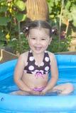 女孩愉快的一点池游泳 库存图片