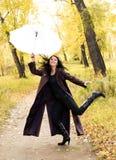女孩愉快的伞 库存照片
