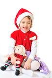 女孩愉快的使用的圣诞老人 库存图片