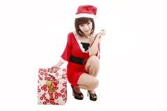 女孩愉快的圣诞老人购物 库存图片
