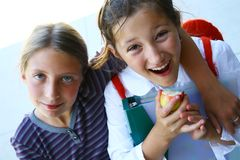 女孩愉快的学校 图库摄影