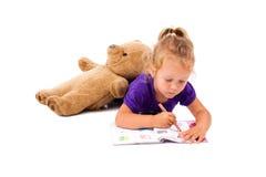 女孩愉快的小的笔记本 库存图片