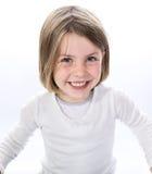 女孩愉快的小的面带笑容 图库摄影