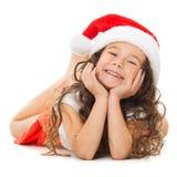 女孩愉快的帽子小的圣诞老人 免版税库存图片