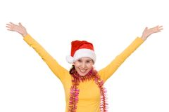 女孩愉快的帽子s圣诞老人 免版税库存照片