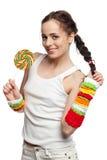 女孩愉快的棒棒糖 免版税库存图片