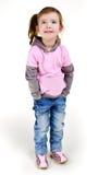 女孩愉快的牛仔裤一点纵向微笑 免版税图库摄影