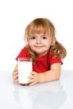 女孩愉快的牛奶 库存图片