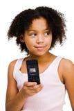 女孩愉快的藏品移动电话 免版税库存照片