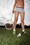女孩打羽毛球 库存照片