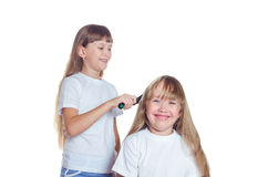 女孩扮演美发师 图库摄影