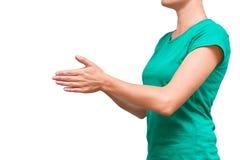 女孩折叠了她的手并且祈祷了或者请求帮忙 背景查出的白色 库存照片