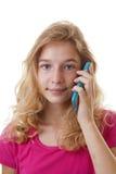 女孩拜访在白色背景的手机 免版税库存照片