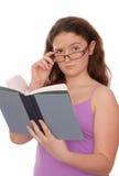 女孩拿着一本书 免版税库存照片