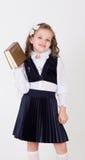 女孩拿着书 免版税库存图片