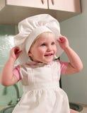 女孩拿着轮毂罩 免版税库存照片