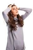 女孩拿着头用手 免版税库存照片