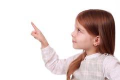 女孩指向您文本的年轻人 免版税库存图片