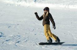 女孩挡雪板年轻人 图库摄影