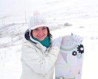 女孩挡雪板 免版税库存照片