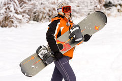 女孩挡雪板 免版税库存图片