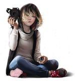 女孩摄影师为射击做准备 免版税库存照片