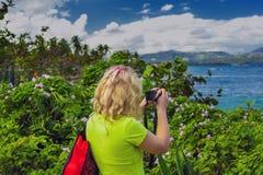 女孩摄影师在多米尼加共和国 免版税库存图片