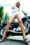 女孩摩托车 免版税库存图片