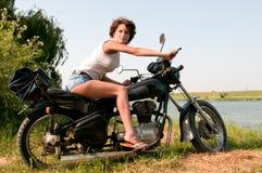 女孩摩托车 库存照片