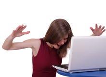 女孩是紧张的与计算机 免版税图库摄影