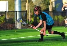 女孩曲棍网兜球大学运动代表队 免版税库存图片