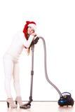 女孩有吸尘器的圣诞老人帽子 库存图片