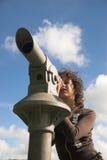女孩望远镜 免版税库存图片