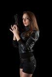 女孩枪摆在 库存图片