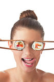 女孩查出的寿司 免版税库存照片