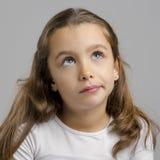 女孩查出的认为的白色 免版税库存照片