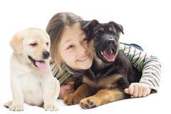女孩查寻与小狗 库存图片