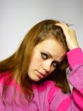 女孩桃红色毛线衣 库存照片