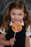 女孩棒棒糖 库存照片
