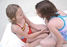 女孩泳装联系 免版税库存图片