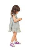 女孩消息移动电话发送 免版税库存图片