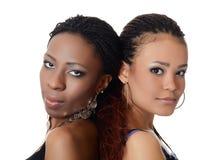女孩混血儿和黑人女孩 库存图片