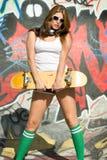 女孩滑板 图库摄影