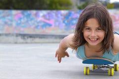 女孩滑板 库存图片