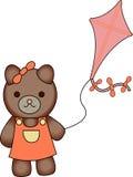 女孩熊飞行风筝 免版税库存照片