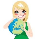 女孩爱恋的地球 库存图片
